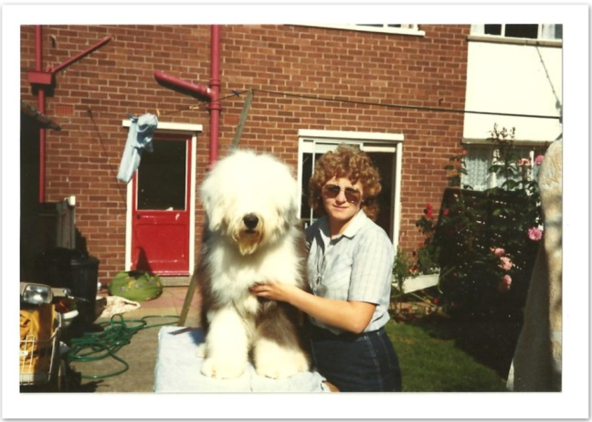 Digger and mum loutside house